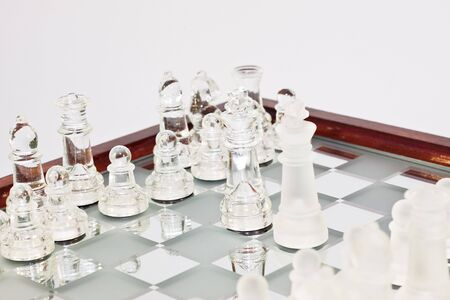 reflektion: chess board game on white background Stock Photo
