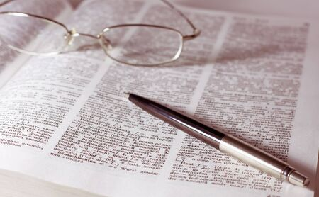 Glasses with pen on the book. Vintage style Stock Photo - 5958252