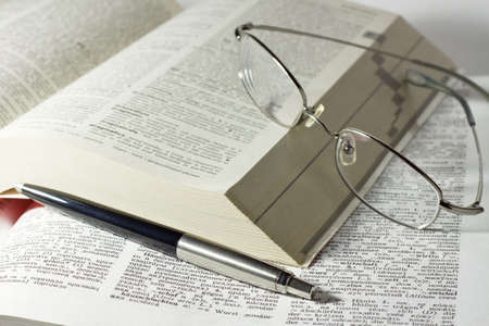 close up detail of a books with reading glasses and pen Stock Photo - 5984326