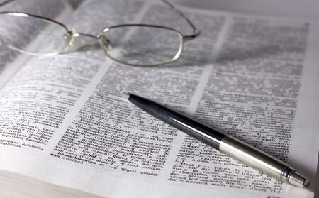 Glasses with pen on the book Stock Photo - 5984328