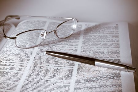 Open book with glasses and pen. Vintage style Stock Photo - 6001366