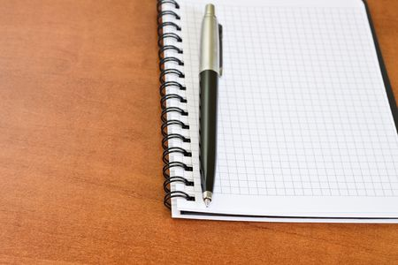 Pen with notebook on the desk photo