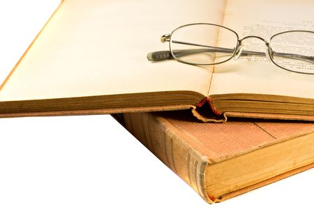 vintage book and glasses isolated on white Stock Photo - 6080630