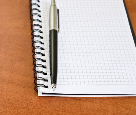 Office desk with pen and notebook photo