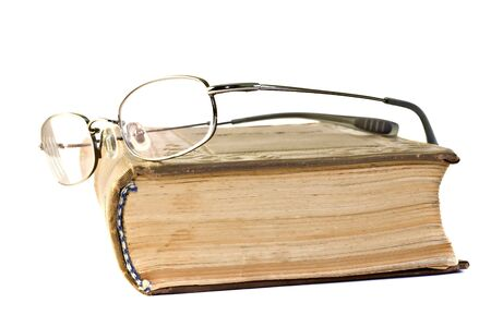 nearsighted: eyeglass on a old book isolated on white