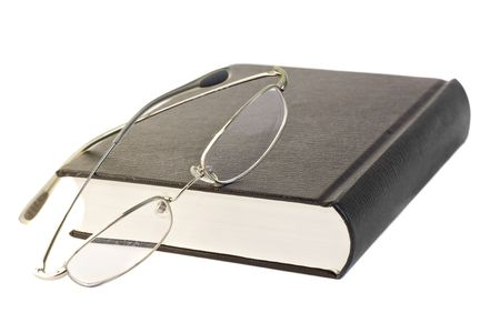 Eyeglasses on book Stock Photo - 6234282