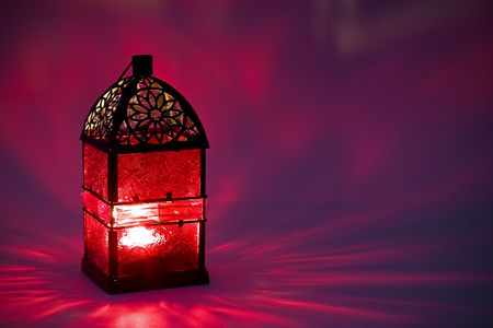 Burning lantern in the dark photo