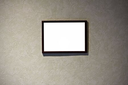 empty frame in a room against a grunge wall photo