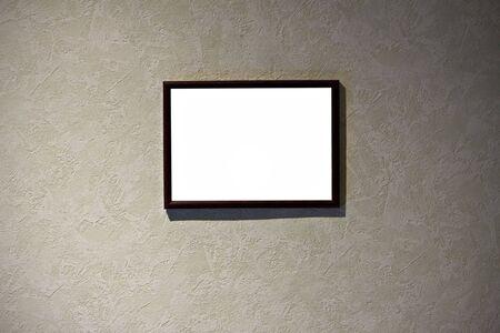 leeg frame in een kamer tegen een muur van grunge