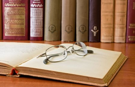 book and glasses in library photo