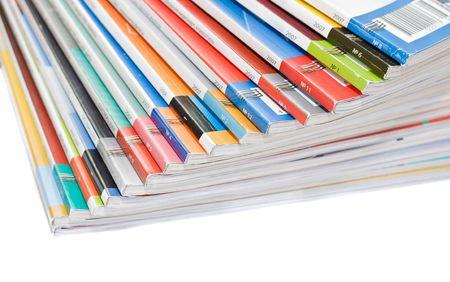 Stapel kleurrijke tijd schriften geïsoleerd via witte achtergrond Stockfoto