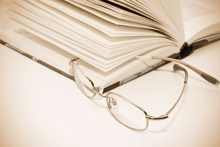 Book with Glasses. Vintage style photo