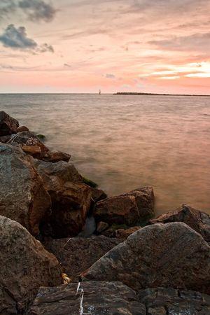 Rocky beach and red sunset. Florida, USA photo