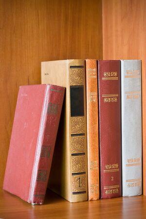 very old books in a shelf photo