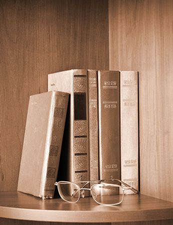 Vintage photo of old books and glasses on a shelf Stock Photo - 6499897