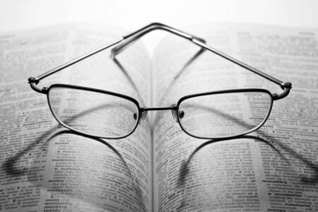 schoolbook: Reading glasses on a dictionary
