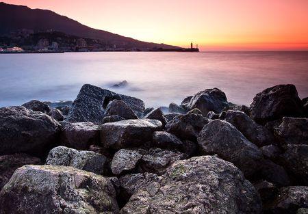 sunrise on the rocky beach. Black sea, Yalta, Ukraine photo