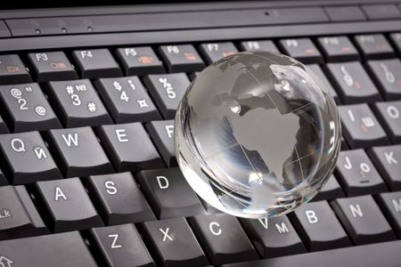 white glass globe on a laptop keyboard Stock Photo - 7154157