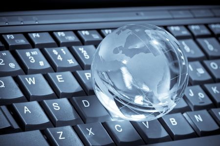 glass globe on a laptop keyboard Stock Photo - 7154160
