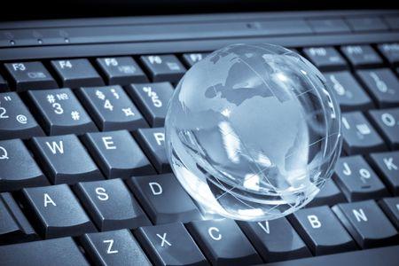 glass globe on a laptop keyboard Stock Photo - 7154160