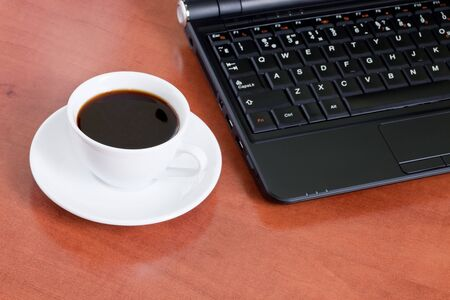 Business concept with laptop and coffee photo
