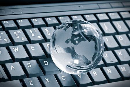 Globe on laptop keyboard Stock Photo - 7235254