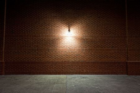 Old street light on a red brick wall.