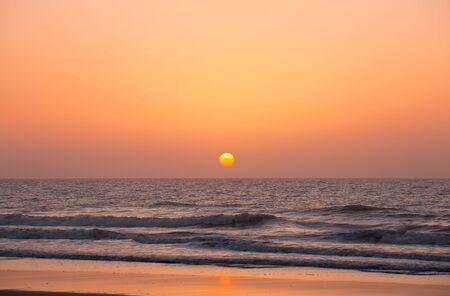 Rising sun over the ocean photo