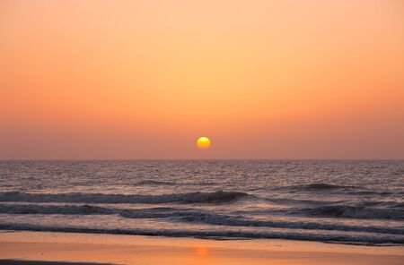 Rising sun over the ocean photo