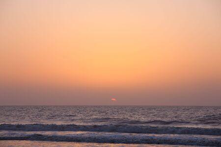 Sunrise over the ocean photo