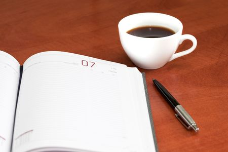 Coffee cup, notebook and pen on the wooden table Stock Photo - 7929734