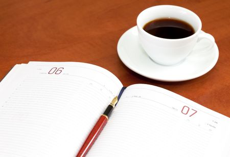 Coffee cup, notebook and pen on the wooden table Stock Photo - 7939762