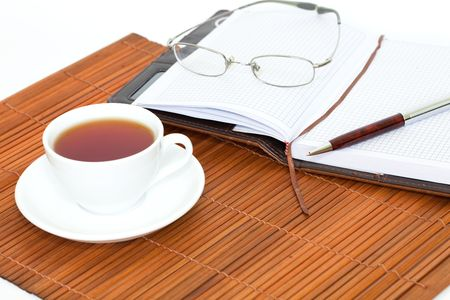 white cup of tea with notebook, glasses and pen Stock Photo - 8009274