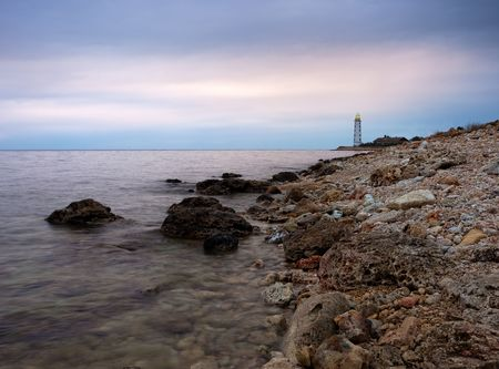 Lighthouse at rocky shore. Crimea, Ukraine photo