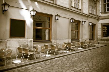 paris street: vintage style photo of outdoor cafe. Viena, Austria Stock Photo