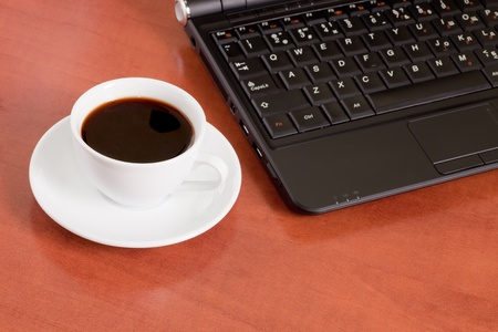 A cup of coffee with a laptop on the desk Stock Photo - 8447147