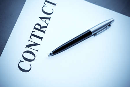 Close-up of pen and contract on the desk photo