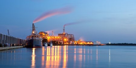 petrochemicals: chemical plant with ships in the night