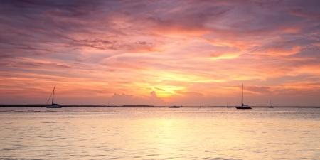 Panoramic view of orange sunset on Atlantic ocean. Florida, USA 스톡 콘텐츠