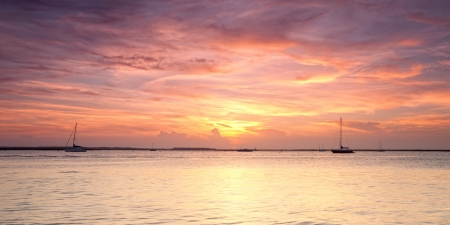Panoramic view of orange sunset on Atlantic ocean. Florida, USA photo