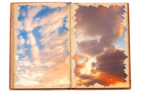 Old opened magic book with a sky background Stock Photo - 9252805