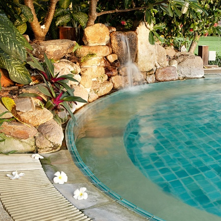 Pool with a waterfall and flowers in a resort Stock Photo