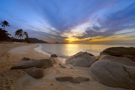 Sunrise at rocky coast of Lamai beach, Koh Samui Island,  Thailand  Stock Photo