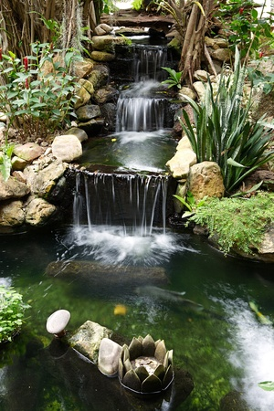 Japanese garden waterfall with pond