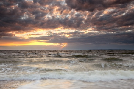 Panoramic view of cloudy sunset on Atlantic ocean photo