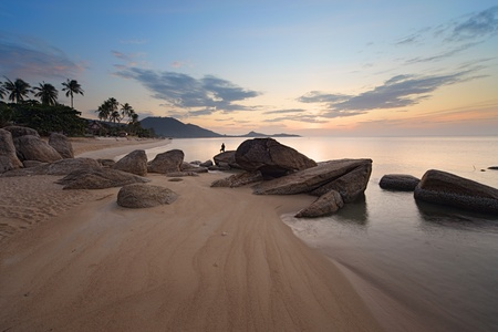 Sunrise at rocky coast of Lamai beach, Koh Samui Island, Thailand