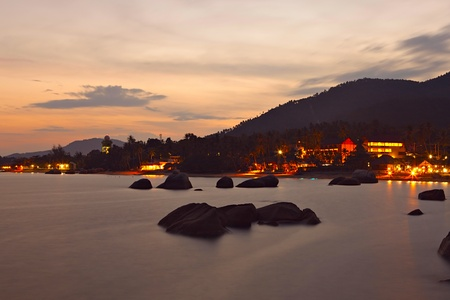 Rocky coast of Lamai beach after dark, Koh Samui Island,  Thailand