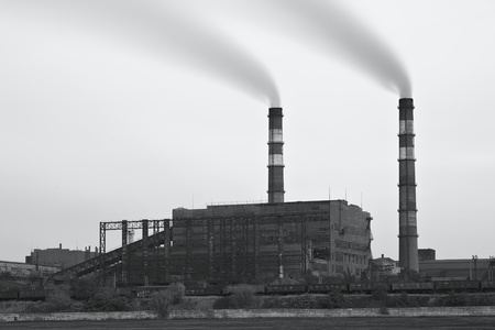 Black and white photo of plant with smoke. Air pollution  스톡 콘텐츠