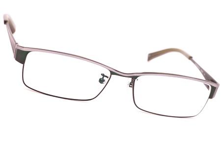 eye wear: Un par de cl�sicos de metal gafas de montura aislado en blanco Foto de archivo