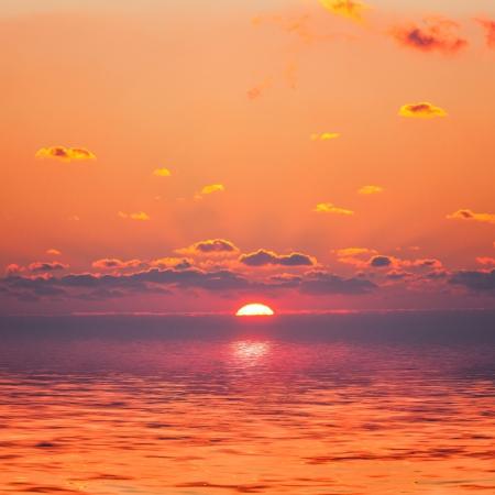 horizon reflection: Red sunrise on the ocean